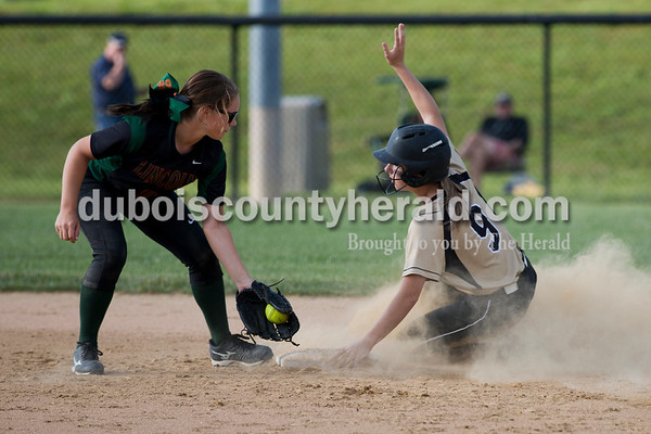 Jasper's Jessica Mehringer slid safely into second base during Thursday's 3A softball sectional semifinal game in Jasper. Vincennes Lincoln defeated Jasper 1-0. Sarah Ann Jump/The Herald