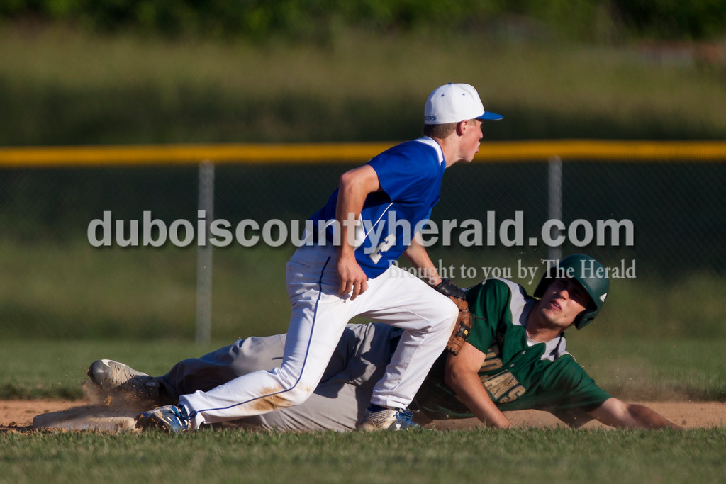 Tegan Johnston/The Herald<br /> Northeast Dubois' Case Eisenhut tagged out a Wood Memorial runner as he tried to steal second base during Monday's Class 1A sectional championship in Dubois. Northeast Dubois defeated Wood Memorial 5-1.