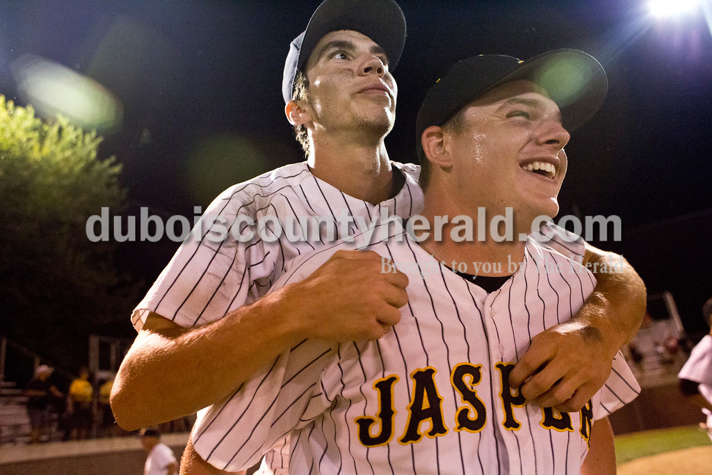 Jasper's Mason Thewes gave Eric Nordhoff a piggy-back ride as they searched for Nordhoff's parents following Monday's 3A baseball sectional championship game in Jasper. Jasper defeated Princeton 5-0. Sarah Ann Jump/The Herald