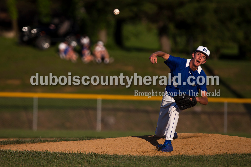Tegan Johnston/The Herald<br /> Northeast Dubois' Peyton Hurt delivered a pitch during Monday's Class 1A sectional championship in Dubois. Northeast Dubois defeated Wood Memorial 5-1.