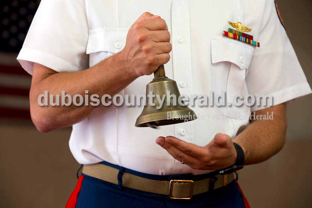 Chris Fleck of Jasper, vice president of the Dubois County Veterans Council, rang a bell to honor Dubois County veterans that have passed away since last Memorial Day during Saturday's Dubois County Veterans Council Memorial Day Service at VFW Post 1907 in Jasper. Sarah Ann Jump/The Herald