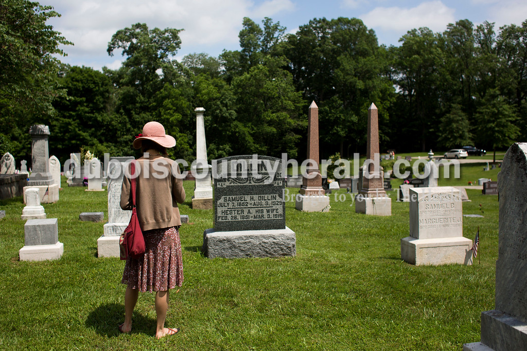"Tegan Johnston/The Herald<br /> Sasha Dillin Wright of Oakland, Cali., visited the grave sites of relatives while attending the Shiloh bicentennial celebration at Shiloh Meeting House in Ireland. Dozens gathered to enjoy vocal performances, a brief history on the historic site, desserts and more. Scotish-Irish pioneers built ""Old Shiloh,"" a small round log church, in 1817, but the present meeting house was build in 1849."