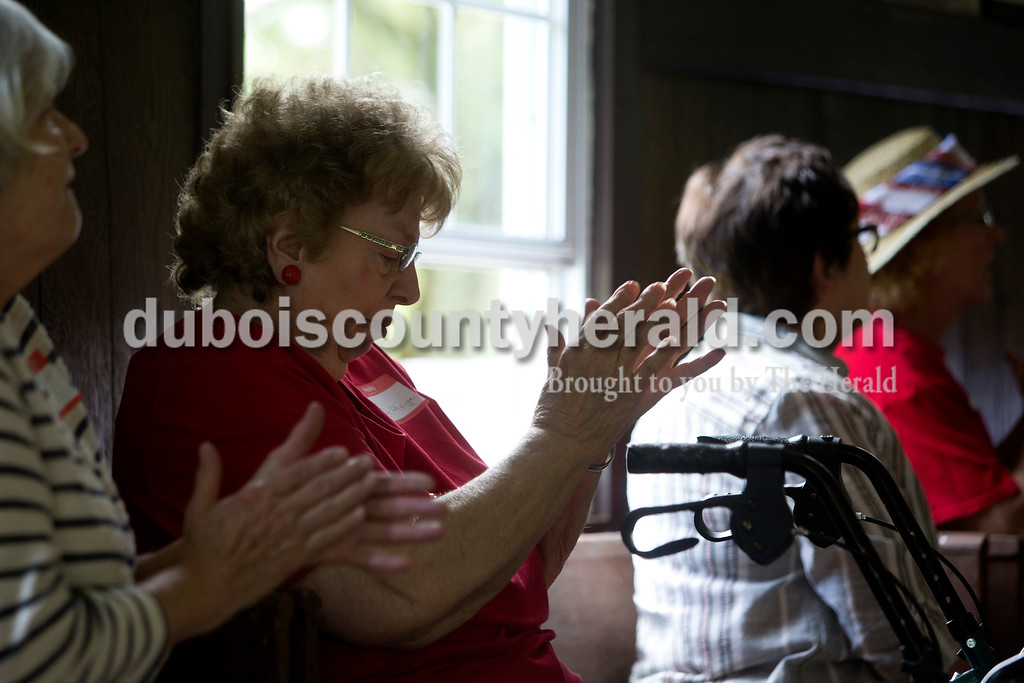 "Tegan Johnston/The Herald<br /> Bonnie Wininger of Jasper clapped after listening to a performance during the Shiloh bicentennial celebration at Shiloh Meeting House in Ireland. Dozens gathered to enjoy vocal performances, a brief history on the historic site, desserts and more. Scotish-Irish pioneers built ""Old Shiloh,"" a small round log church, in 1817, but the present meeting house was build in 1849."