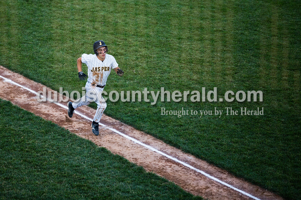 Jasper's Austin Simmers raced home for the Wildcat's first run during Monday's 3A baseball sectional championship game in Jasper. Jasper defeated Princeton 5-0. Sarah Ann Jump/The Herald