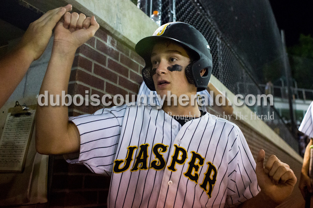 Jasper's Grant Ahlbrand was welcomed back to the dugout after scoring a run during Monday's 3A baseball sectional championship game in Jasper. Jasper defeated Princeton 5-0. Sarah Ann Jump/The Herald