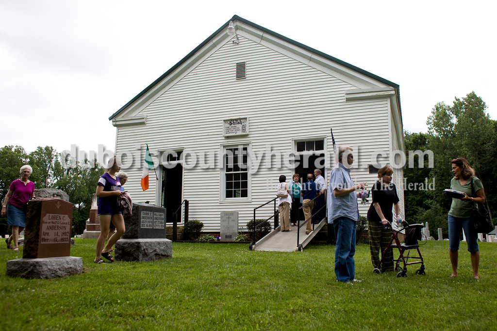 "Tegan Johnston/The Herald<br /> Attendees wandered outside the Shiloh Meeting House to chat and to peruse the cemetery after the Shiloh bicentennial celebration in Ireland. Dozens gathered to enjoy vocal performances, a brief history on the historic site, desserts and more. Scotish-Irish pioneers built ""Old Shiloh,"" a small round log church, in 1817, but the present meeting house was build in 1849."