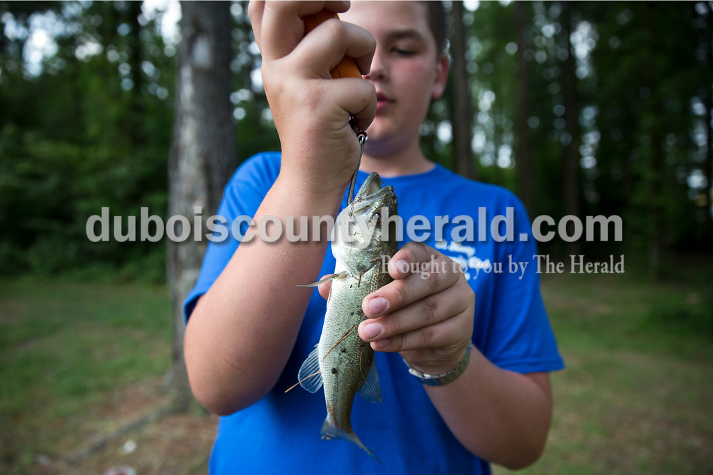 Levi Schaeffer of Huntingburg, 14, weighed a bass he caught during the fishing derby at the Jasper Outdoor Recreation on Saturday morning. Sarah Ann Jump/The Herald