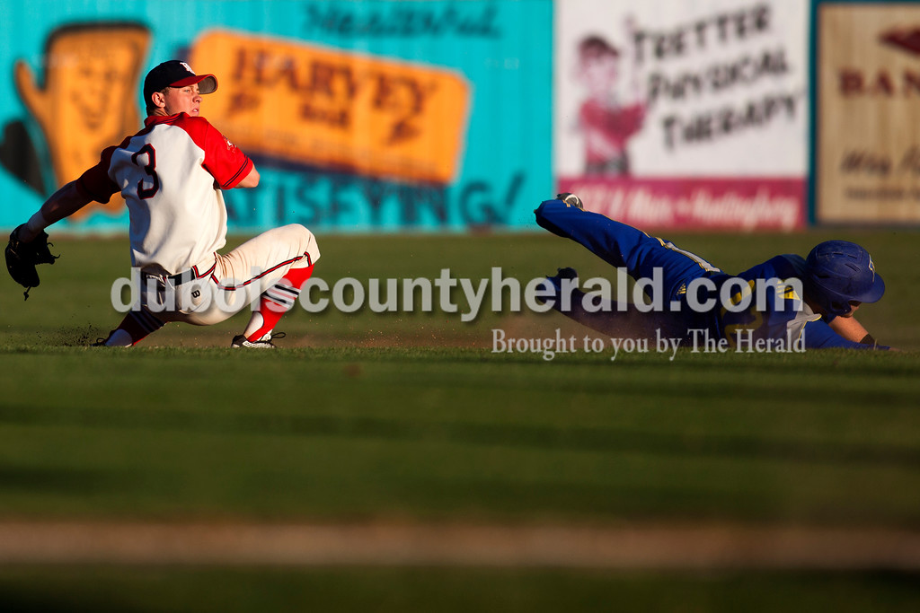 Tegan Johnston/The Herald<br /> Dubois County Bombers' Craig Shepherd of Jasper caught the ball while covering second during Thursday night's game at League stadium in Huntingburg. Dubois County defeated Henderson 6-1.