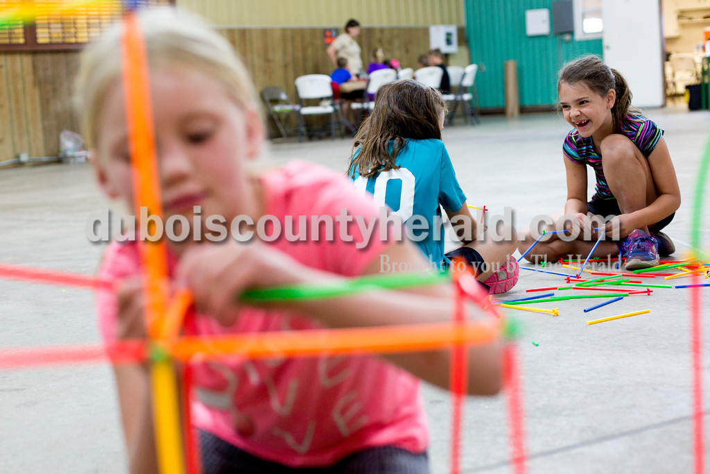 Tegan Johnston/The Herald<br /> Chloe Betz of Celestine, 8, from left, Shelby Steckler of St. Henry, 7, and Brynlee Wehr of Ireland, 8, built with Strawbees during Wednesday's Exploring 4-H Day Camp in the Clover Pavilion at the the Dubois County 4-H Fairgrounds in Bretzville. Purdue Extension hosted two days of Makers Mania: Experience a Day of Tinkering, Building, & Designing, a one-day camp that allowed children from kindergarten to second-grade to create and to experiment with different technology.