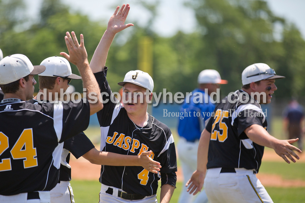 Jasper's Reece Kleinhelter high-fived his teammates between inning during Saturday's Class 3A regional semifinal against Silver Creek at North Harrison High School in Ramsey. Jasper defeated Silver Creek 13-3 in six innings. Sarah Ann Jump/The Herald
