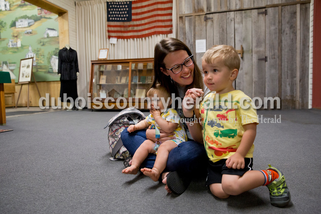 Betsy Hoffman of Jasper and her sons nine-month-old Adam and two-year-old Max listened during story time at the Dubois County Museum in Jasper on Tuesday morning. Sarah Ann Jump/The Herald
