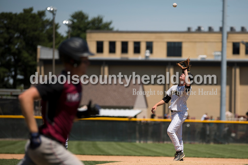 Jasper's Reece Kleinhelter caught the ball as the Northview runner headed towards first during Saturday's Class 3A baseball semistate game at Ruxer Field in Jasper. Jasper defeated Northview 3-2 in 10 innings. Sarah Ann Jump/The Herald