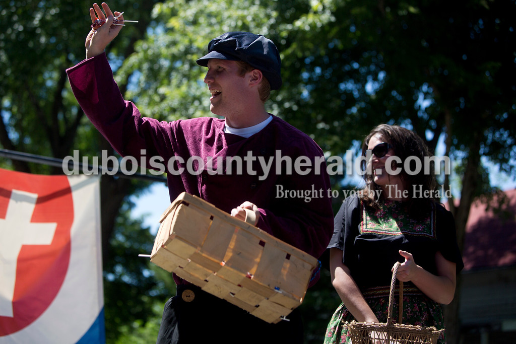 Tegan Johnston/The Herald<br /> Kru Allen of Holland, 18, threw candy with Rhegann Fetter of Huntingburg from the Zoar United Methodist Church float during the parade at the town of Stendal's 150 year celebration on Saturday. The two-day event offered family fun activities including a Tin Fest car show, an airplane flyover, a parade through town, musical performances, food and more. Stendal High School alumni also enjoyed a reunion and historical display during the town's festival.