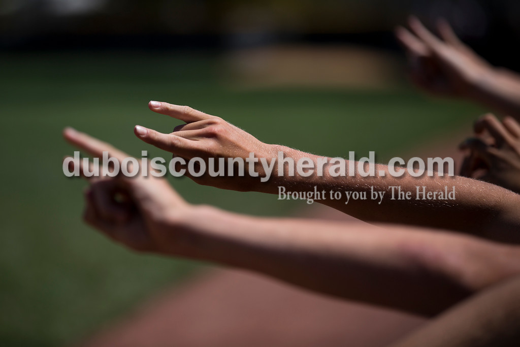 Jasper players signaled that the team had two outs while playing defense during Saturday's Class 3A baseball semistate game at Ruxer Field in Jasper. Jasper defeated Northview 3-2 in 10 innings. Sarah Ann Jump/The Herald