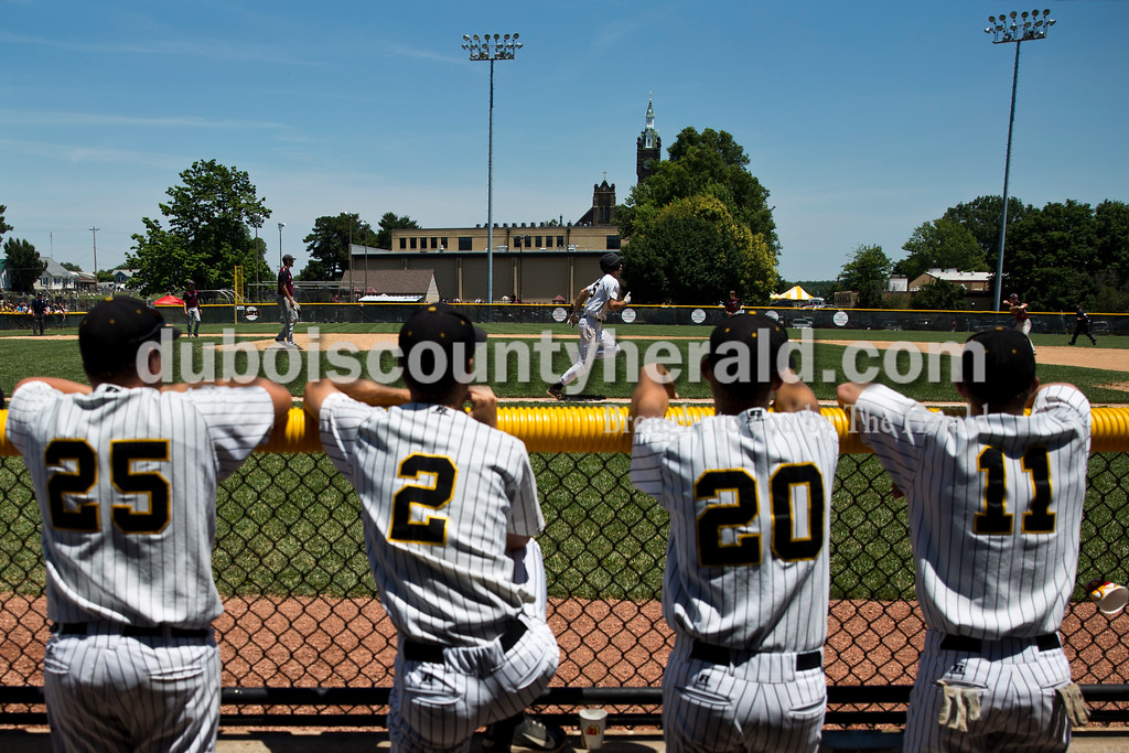 Jasper's Austin Simmers ran to first base as teammates Mason Thewes, left, Tanner Egbert, Seth Mendel and Cameron Heeke watched from the dugout during Saturday's Class 3A baseball semistate game at Ruxer Field in Jasper. Jasper defeated Northview 3-2 in 10 innings. Sarah Ann Jump/The Herald