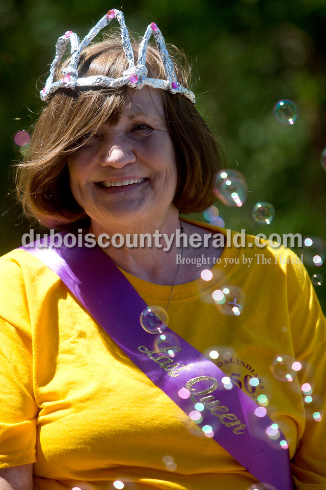 Tegan Johnston/The Herald<br /> Stendal High School's last homecoming queen Carolyn Richardson Aydelott of Coe rode in a float during the parade at the town of Stendal's 150 year celebration on Saturday. The two-day event offered family fun activities including a Tin Fest car show, an airplane flyover, a parade through town, musical performances, food and more. Stendal High School alumni also enjoyed a reunion and historical display during the town's festival.