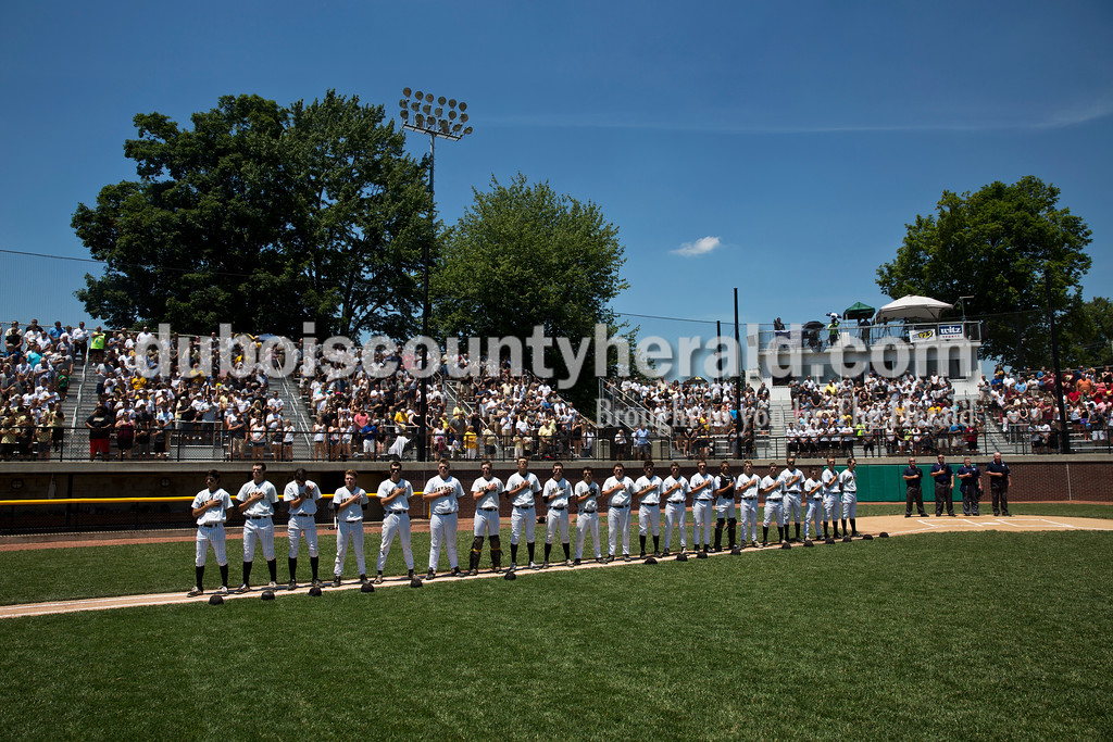 The Jasper baseball team and fans observed the national anthem during Saturday's Class 3A baseball semistate game at Ruxer Field in Jasper. Jasper defeated Northview 3-2 in 10 innings. Sarah Ann Jump/The Herald
