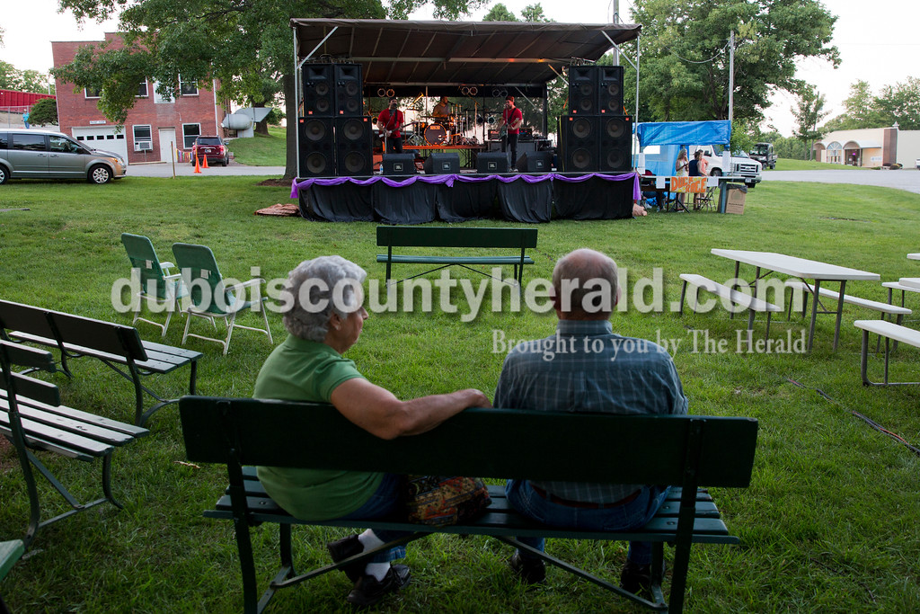 Dorothy and Lee Schaefer of Fulda listened to the Greenbrier, Tenn.-based Christian rock band I Am Spartacus play during the Sisters' Summer Social at Monastery Immaculate Conception in Ferdinand on Friday. Sarah Ann Jump/The Herald