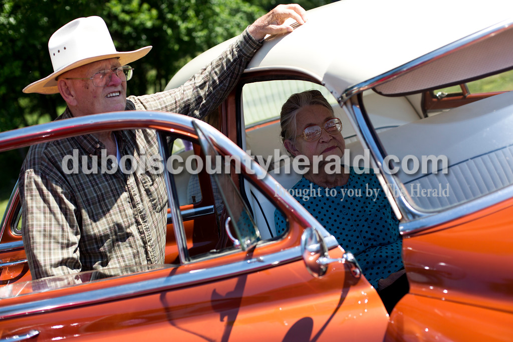 Tegan Johnston/The Herald<br /> Ronald Green of Oakland City and his wife, Raydene, waited for the judging results of the Tin Fest car show with their '52 Chevrolet during the town of Stendal's 150 year celebration on Saturday. The two-day event offered family fun activities including a Tin Fest car show, an airplane flyover, a parade through town, musical performances, food and more. Stendal High School alumni also enjoyed a reunion and historical display during the town's festival.
