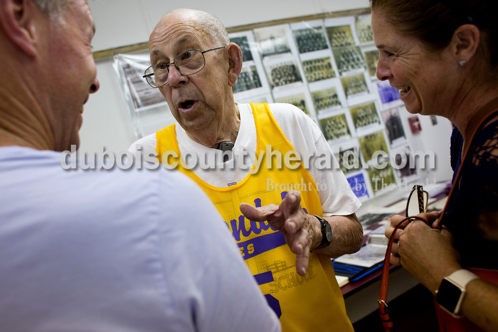 Tegan Johnston/The Herald<br /> Paul Hagemeyer of Stendal, center, recounted memories on the high school basketball team to Mike and Michelle Luker of New Palestine during the town of Stendal's 150 year celebration on Saturday. The two-day event offered family fun activities including a Tin Fest car show, an airplane flyover, a parade through town, musical performances, food and more. Stendal High School alumni also enjoyed a reunion and historical display during the town's festival.