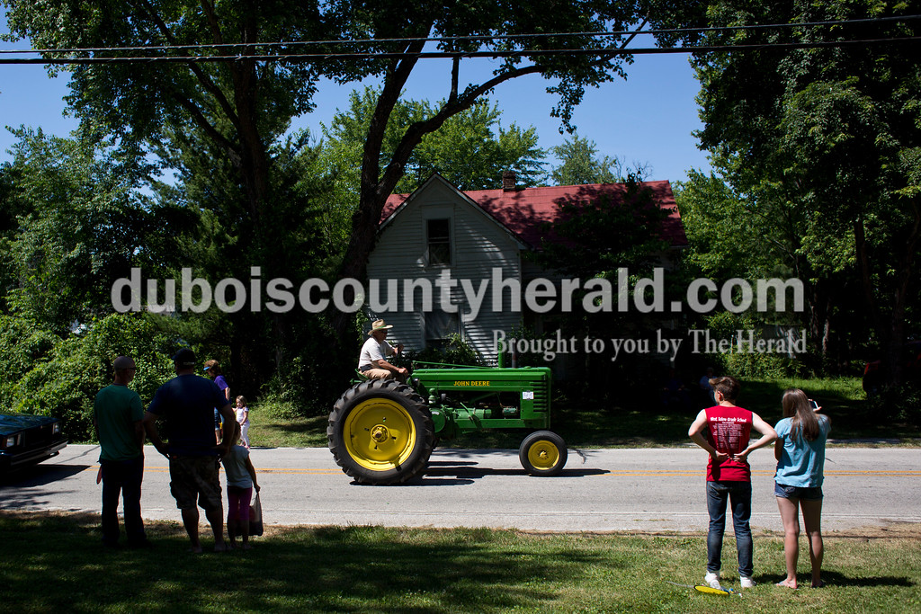 Tegan Johnston/The Herald<br /> Mike Whaley of Otwell drove his tractor in the parade during the town of Stendal's 150 year celebration on Saturday. The two-day event offered family fun activities including a Tin Fest car show, an airplane flyover, a parade through town, musical performances, food and more. Stendal High School alumni also enjoyed a reunion and historical display during the town's festival.