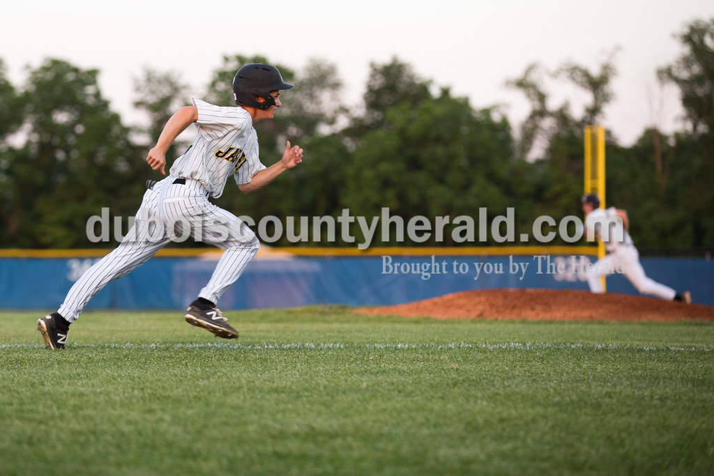 Jasper's Noah Weidenbenner sprinted home for Jasper's first run during Saturday's Class 3A regional championship against Lawrenceburg at North Harrison High School in Ramsey. Jasper defeated Lawrenceburg 4-2. Sarah Ann Jump/The Herald