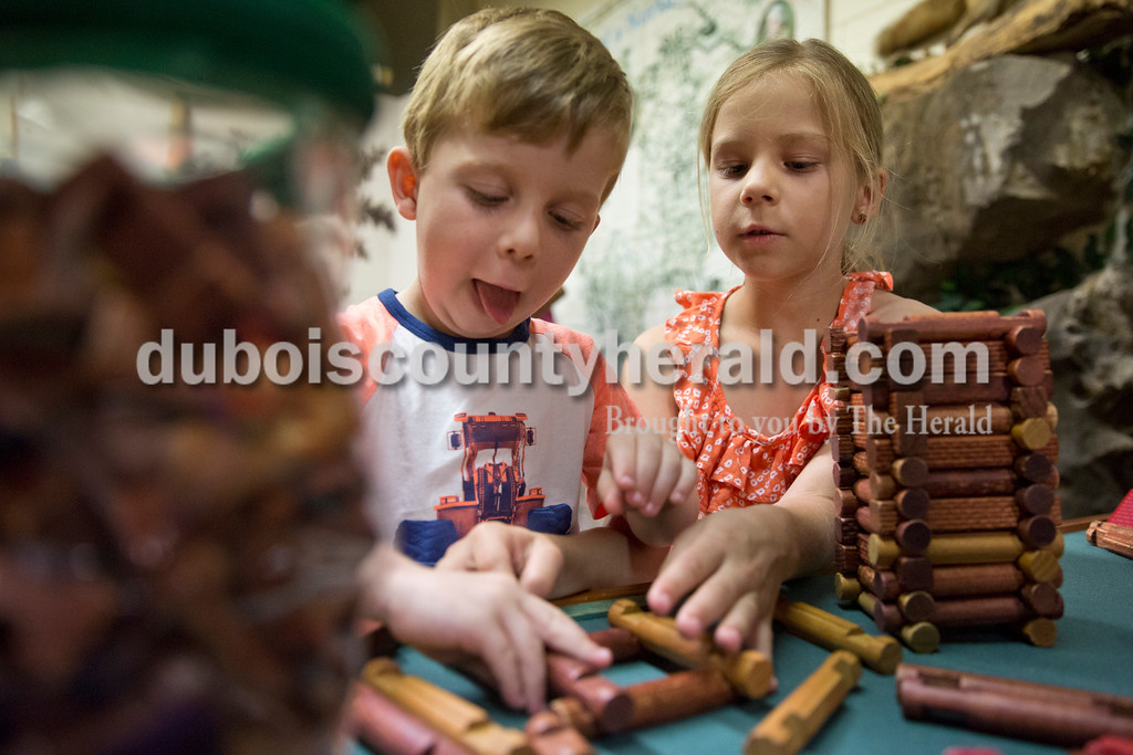 Alex Jerger of Jasper, 4, and his sister Leah, 8, played with Lincoln Logs during story time at the Dubois County Museum in Jasper on Tuesday morning. Sarah Ann Jump/The Herald