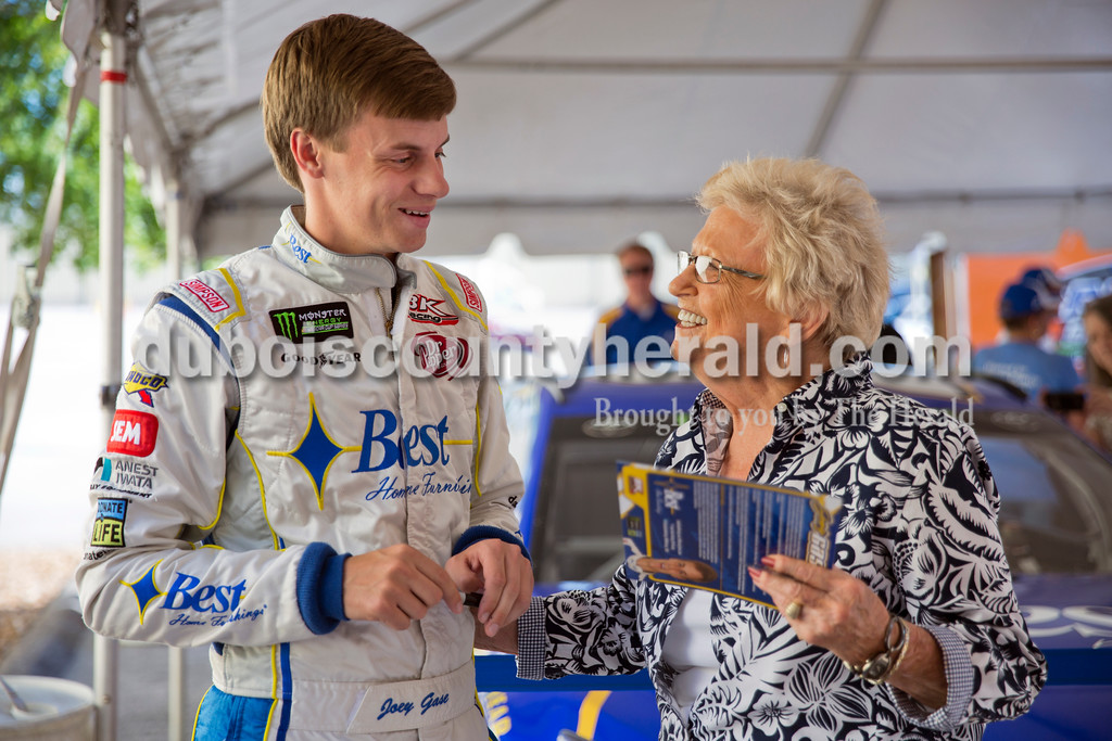 Sarah Ann Jump/The Herald<br /> NASCAR driver Joey Gase, left, talked with Pearline Brahm of Ferdinand during Joey Gase Day at Best Home Furnishings in Ferdinand Tuesday evening. Brahm asked Gase for an autographed photo to send to her NASCAR-fan grandchildren in Atlanta.