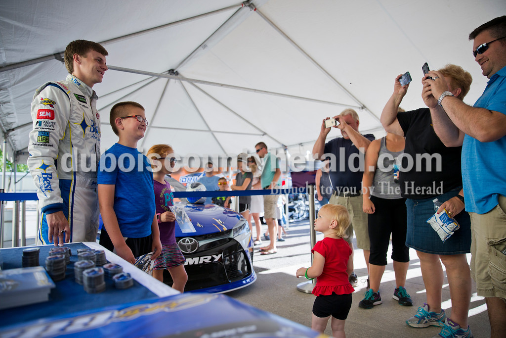 Sarah Ann Jump/The Herald<br /> NASCAR driver Joey Gase posed for photos with Bryce Memmer of Ferdinand, 9, and his sister Paige, 8, during Joey Gase Day at Best Home Furnishings in Ferdinand Tuesday evening.