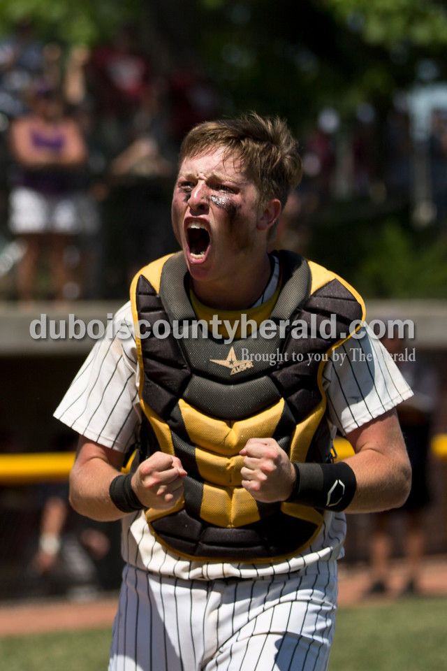 Jasper catcher Adam Hedinger celebrated winning Saturday's Class 3A baseball semistate game at Ruxer Field in Jasper. Jasper defeated Northview 3-2 in 10 innings. Sarah Ann Jump/The Herald
