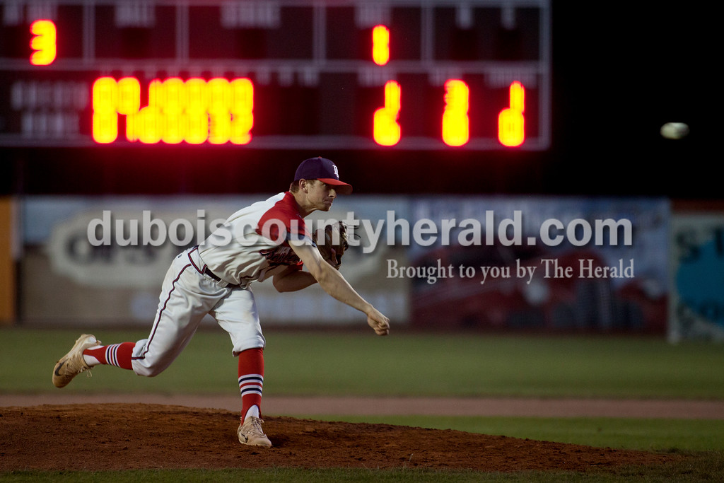 Tegan Johnston/The Herald<br /> Dubois County Bombers' Jordan Cozart delivered a pitch during Thursday night's game at League stadium in Huntingburg. Dubois County defeated Henderson 6-1.