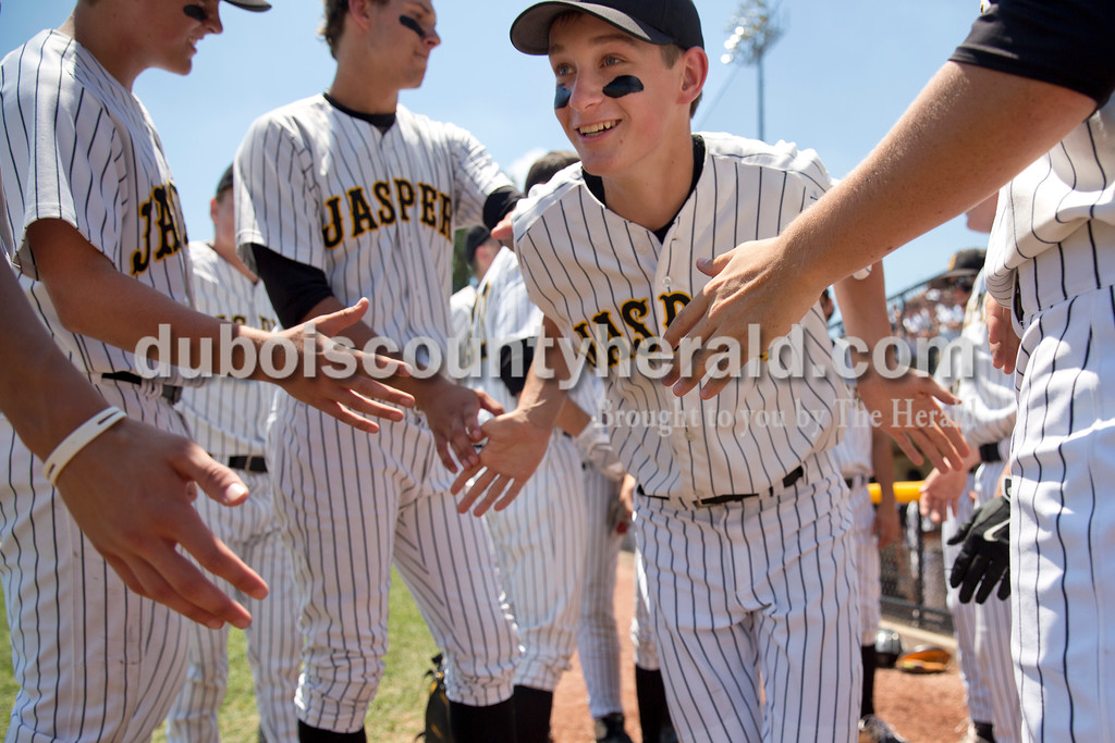 Jasper's Grant Ahlbrand high-fived his teammates as he was introduced before Saturday's Class 3A baseball semistate game at Ruxer Field in Jasper. Jasper defeated Northview 3-2 in 10 innings. Sarah Ann Jump/The Herald