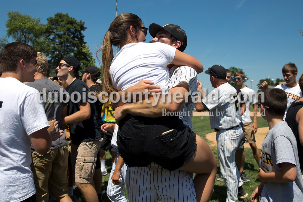 Jasper's Eric Nordhoff hugged his girlfriend Breanna Bounds, a rising senior at Jasper High School, as the team celebrated their win over Northview during Saturday's Class 3A baseball semistate game at Ruxer Field in Jasper. Jasper defeated Northview 3-2 in 10 innings. Sarah Ann Jump/The Herald