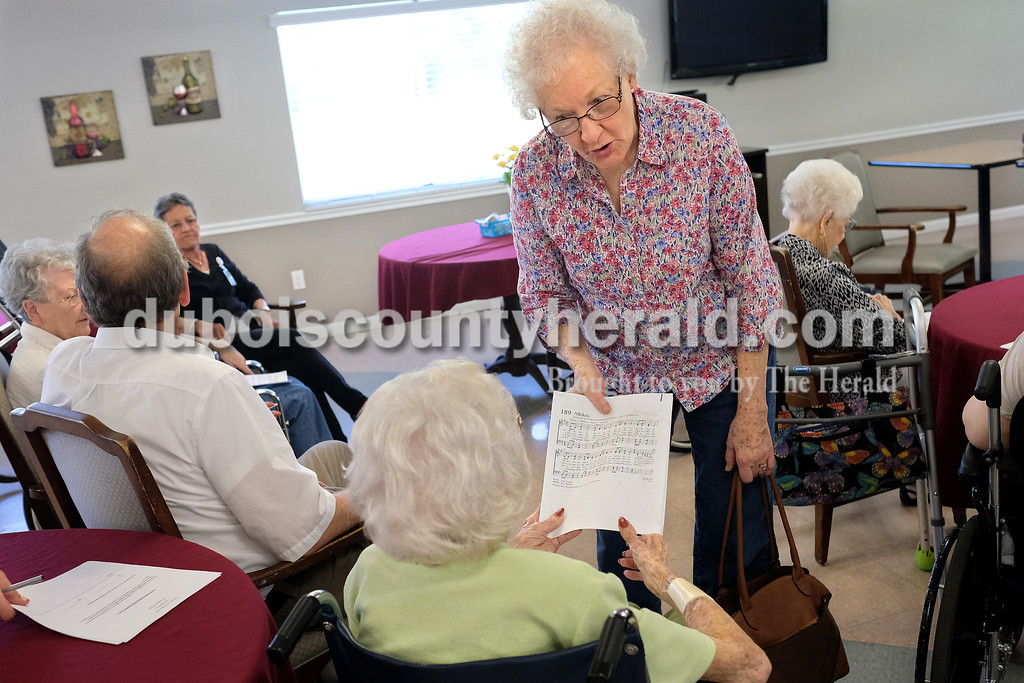 Dave Weatherwax/The Herald<br /> On the third Monday of the month, members of Salem United Church of Christ in Huntingburg conduct a brief service for interested residents at The Waters of Huntingburg. During last month's service, Norma Trent of Huntingburg chatted with resident Doris Schulte as Trent handed out music sheets.