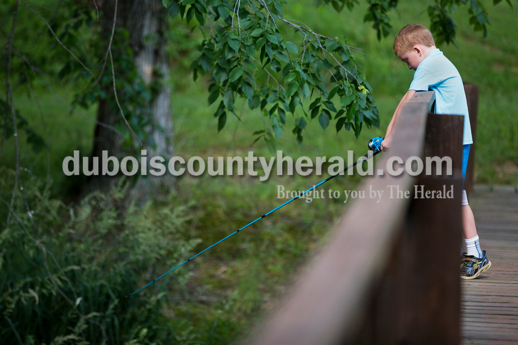 Evan Walls of Washington, 7, fished over a bridge during the fishing derby at the Jasper Outdoor Recreation on Saturday morning. Sarah Ann Jump/The Herald