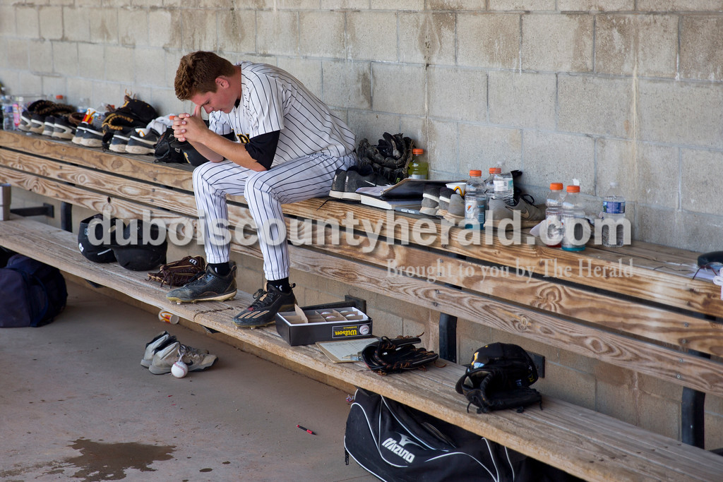 Jasper's Reece Kleinhelter sat in the dugout before pitching the seventh inning during Saturday's Class 3A baseball semistate game at Ruxer Field in Jasper. Jasper defeated Northview 3-2 in 10 innings. Sarah Ann Jump/The Herald