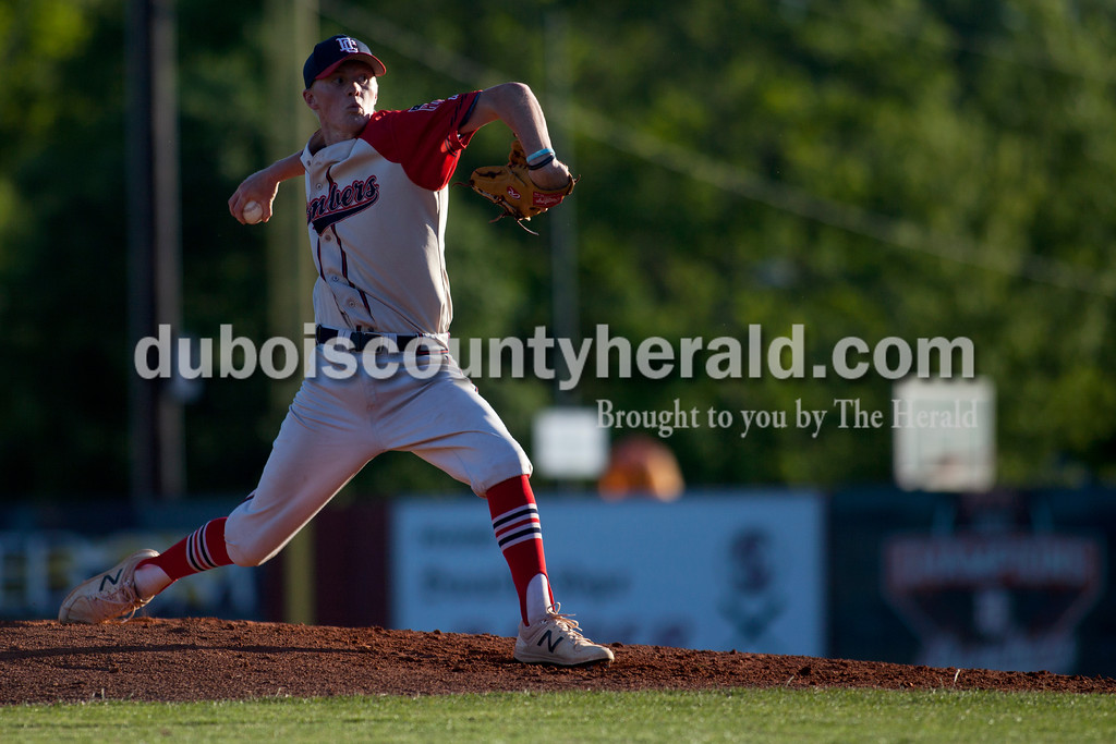 Tegan Johnston/The Herald<br /> Dubois County Bombers' Chance Hitchcock of Martinsville delivered a pitch during Thursday night's game at League stadium in Huntingburg. Dubois County defeated Henderson 6-1.