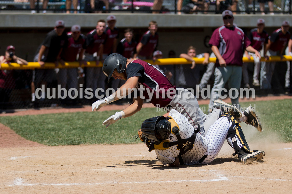 Northview's Brigham Booe collided with Jasper catcher Adam Hedinger on the final play of the game during Saturday's Class 3A baseball semistate game at Ruxer Field in Jasper. Jasper defeated Northview 3-2 in 10 innings. Sarah Ann Jump/The Herald