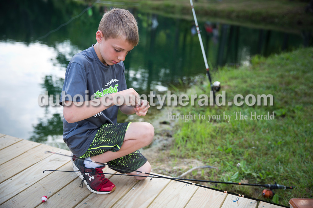 Camden Cole of Schnellville, 8, baited his hook with a worm during the fishing derby at the Jasper Outdoor Recreation on Saturday morning. Sarah Ann Jump/The Herald