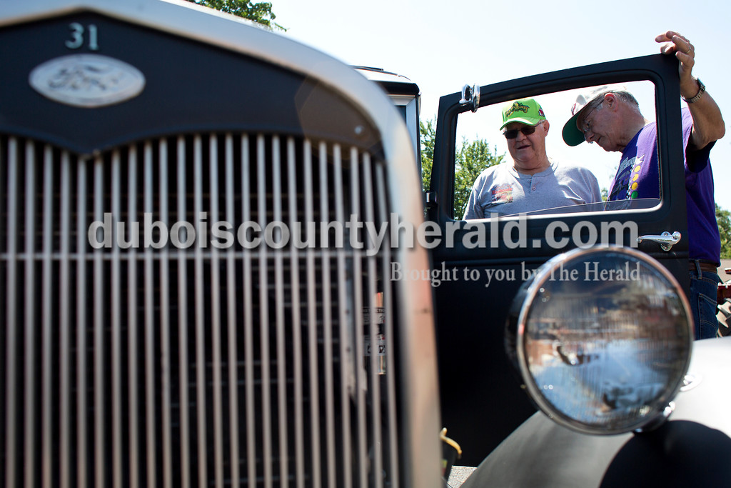 Tegan Johnston/The Herald<br /> Don Patberg of Huntingburg, left, showed his Ford Model A Street Rod to his cousin, Randy Katter of Washington, during the Tin Fest car show at the town of Stendal's 150 year celebration on Saturday. Both Patberg and Katter are originally from Stendal. The two-day event offered family fun activities including a Tin Fest car show, an airplane flyover, a parade through town, musical performances, food and more. Stendal High School alumni also enjoyed a reunion and historical display during the town's festival.