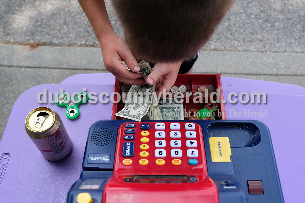 Kaleb Wendholt of Jasper, 9, counted the money the boys had made by early afternoon Monday.