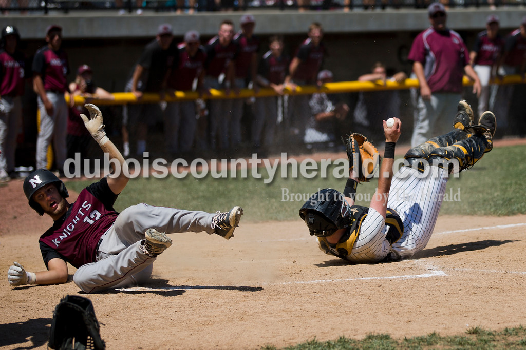 Jasper catcher Adam Hedinger showed the ball after hanging onto it following a collision with Northview's Brigham Booe on the final play of the game during Saturday's Class 3A baseball semistate game at Ruxer Field in Jasper. Jasper defeated Northview 3-2 in 10 innings. Sarah Ann Jump/The Herald