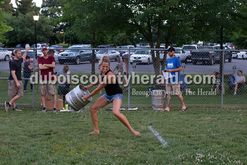 Brittney Lohmiller /The Herald <br /> Karri Meyer of Ferdinand prepared to toss the beer keg during Heimatfest at 18th Street Park Friday evening. Meyer threw the keg 22 feet and won first place.