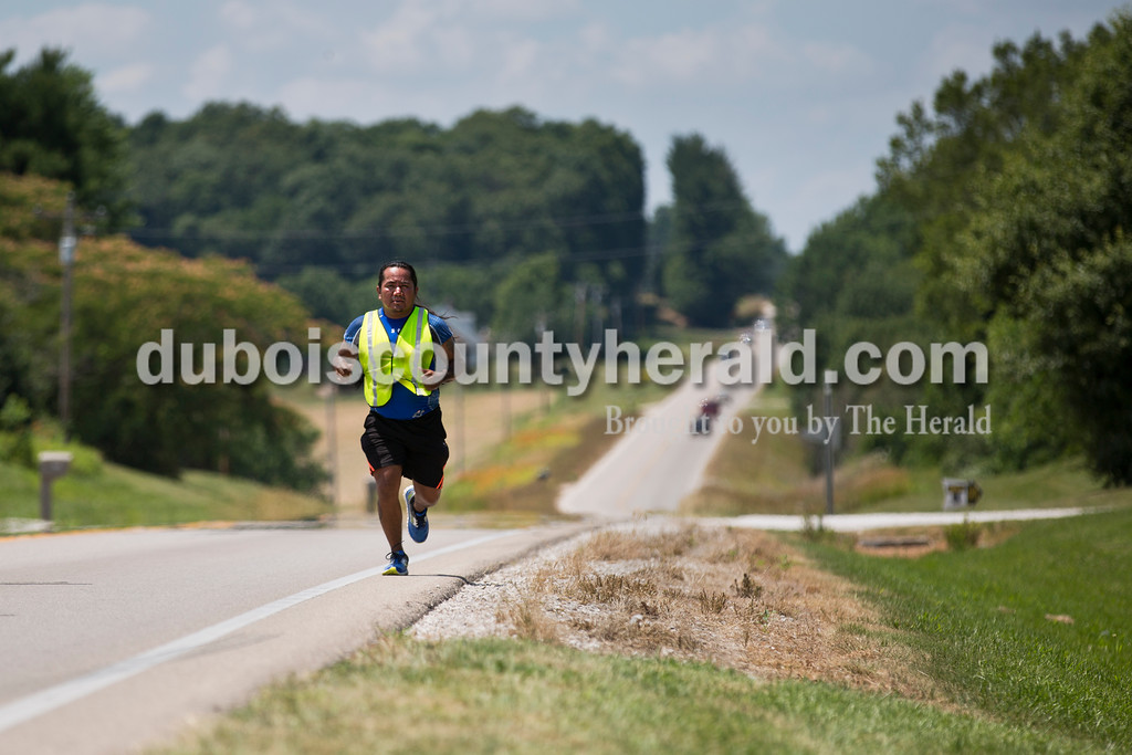 Sarah Ann Jump/The Herald<br /> The Longest Walk 5.2 relay runner Michael Vernon Shortey ran along Highway 64 near Huntingburg on Monday afternoon. The Longest Walk 5.2 Native American group trekked through Dubois County on their way to a Native American gathering in English before continuing on to Washington, DC.