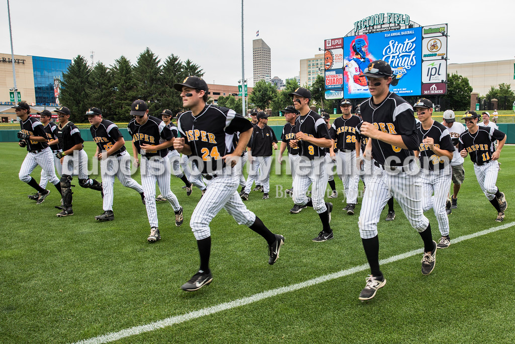 The Wildcats ran back to the dugout after a talk from coach Terry Gobert before Saturday's Class 3A baseball state championship game at Victory Field in Indianapolis. South Bend St. Joseph defeated Jasper 4-0. Sarah Ann Jump/The Herald