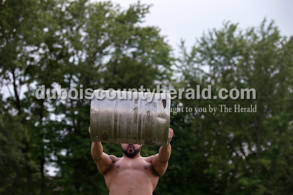 Brittney Lohmiller /The Herald <br /> Aric Dylan Stanish of Santa Claus prepared to toss the beer keg during Heimatfest at 18th Street Park Friday evening. Thirteen people participated in the beer keg toss this year.