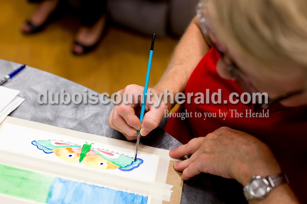 Tegan Johnston/The Herald<br /> Donna Renner of Ireland painted with watercolors while making bookmarks for new patient care packages during Tuesday's Creating Hope art class at Memorial Hospital in Jasper. Renner was a former patient who has been cleared of cancer. The group meets every first and second Tuesday of the month to offer support to patients and caregivers while creating uplifting art.