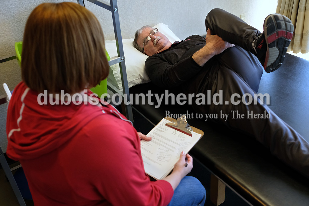 Physical therapist Beth Kendall assisted Steve through some stretches to help with his back pain March 9.