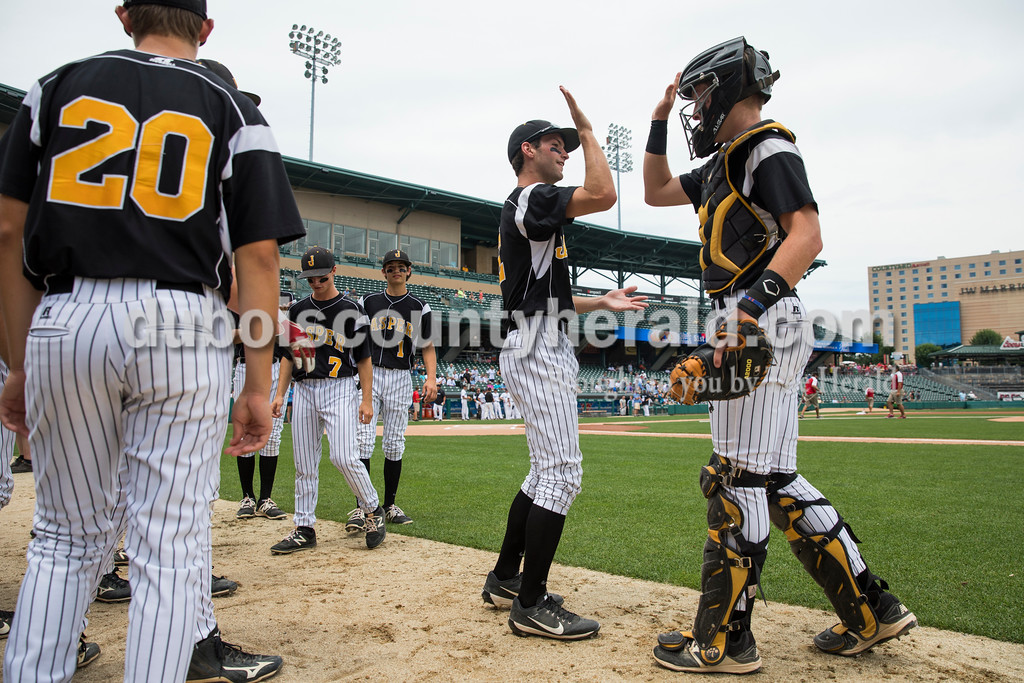 Jasper's Tanner Egbert and Adam Hedinger high-fived before Saturday's Class 3A baseball state championship game at Victory Field in Indianapolis. South Bend St. Joseph defeated Jasper 4-0. Sarah Ann Jump/The Herald