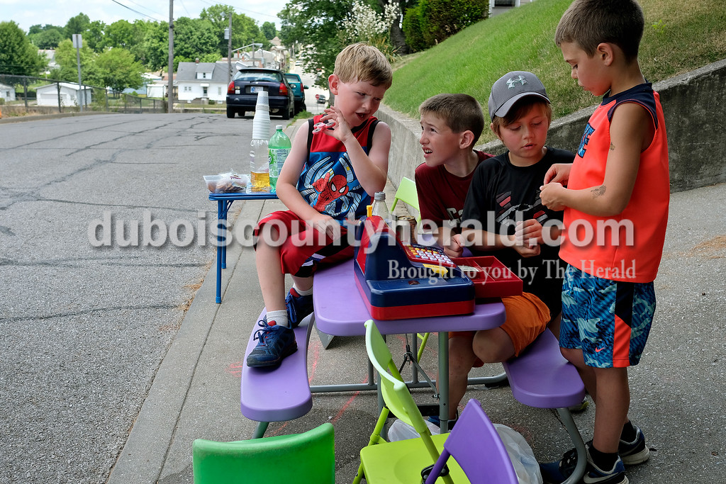 Dave Weatherwax/The Herald<br /> Reid Wendholt, 6, left, his brother, Kaleb, 9, Dylan Durcholz, 9, and Kale Talbert, 9, all of Jasper, started their Monday morning out by playing with a toy cash register and fake money at their Jasper daycare. The activity reminded Kaleb of the lemonade stand they put up around this time last year, so the boys decided to setup shop again. By 1 p.m., they were counting just over $20 in their cash register.